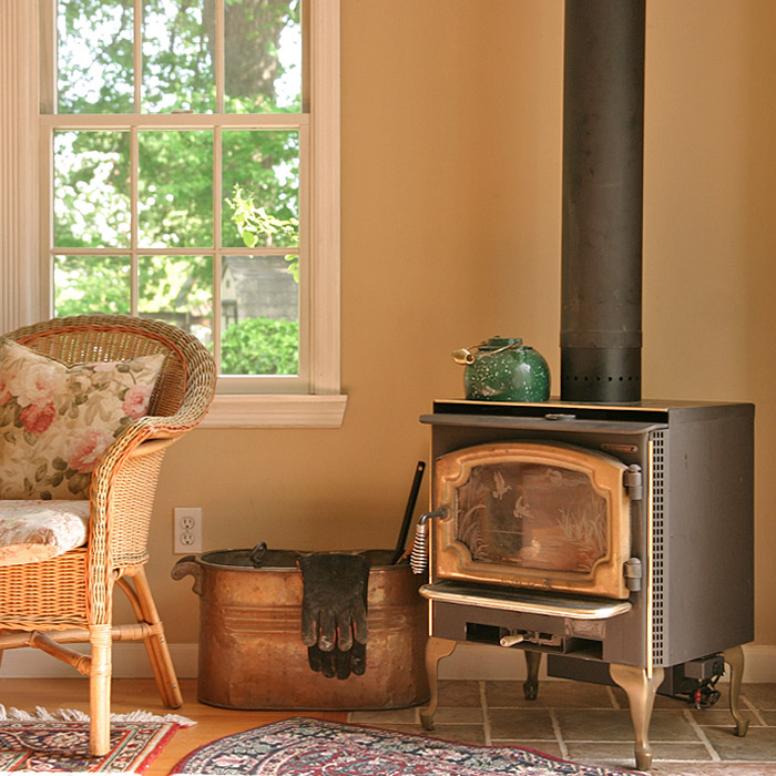 home in norwalk ct has wood burning stove in sunroom