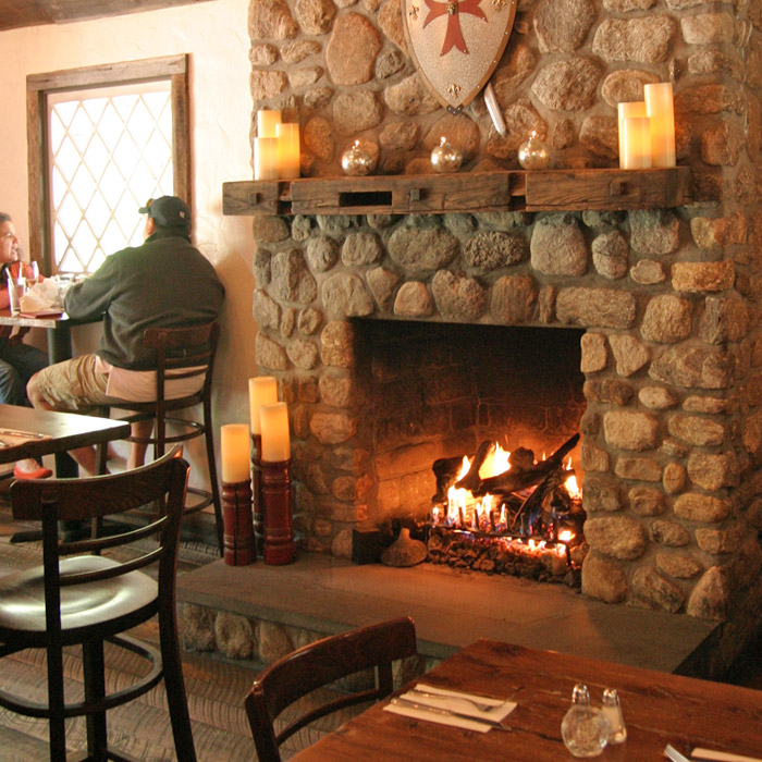restaurant features large stone fireplace converted to use large gas log set in monroe ct