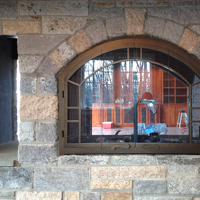 two sided custom stone fireplace at estate home in stamford, greenwich ct area