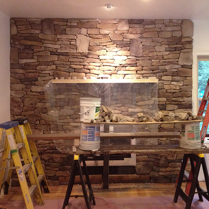manufactured stone applied to surround and wall around fireplace insert in ridgefield ct, newtown ct